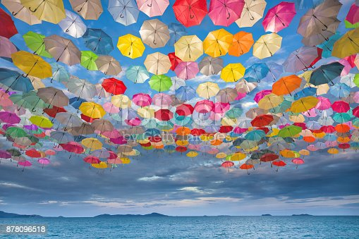 istock Abstract design of umbrellas flying in the sky 878096518