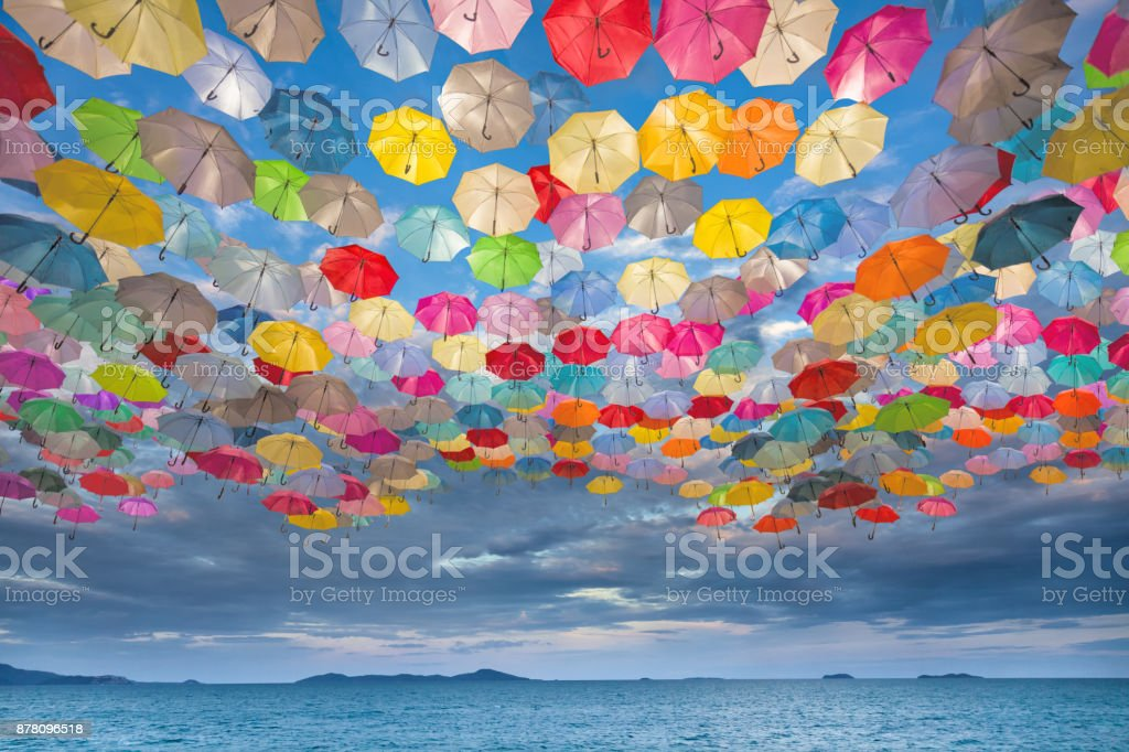 Abstract design of umbrellas flying in the sky stock photo