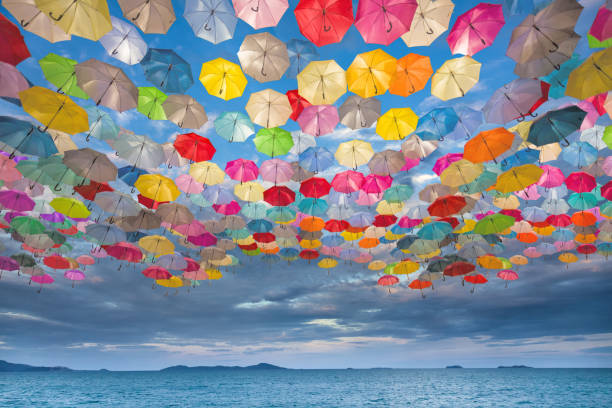 abstract design of umbrellas flying in the sky - umbrellas stock photos and pictures