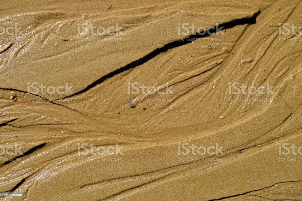 Abstract design pattern formed naturally on beach sand stock photo