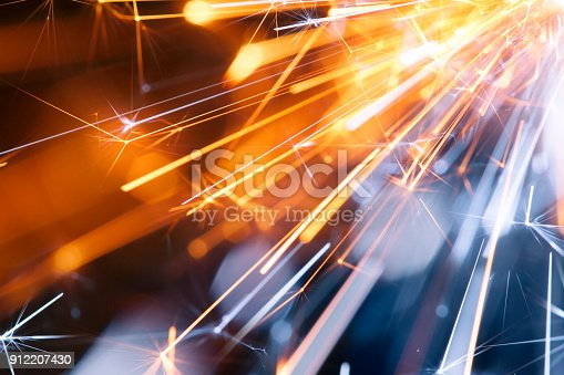 Macro photography of sparks. Great background image for party, celebration or technology.