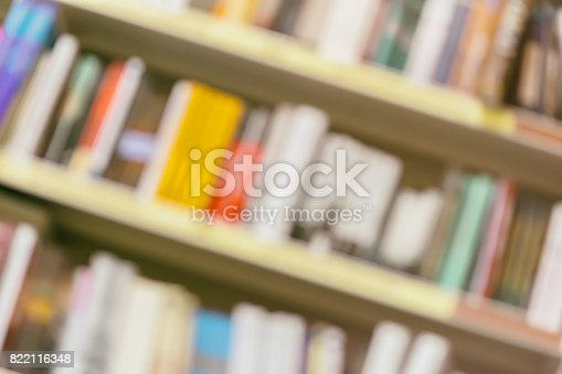 istock Abstract diagonal rows of different colorful books lying on bookshelfs in urban bookshop, vintage picture 822116348
