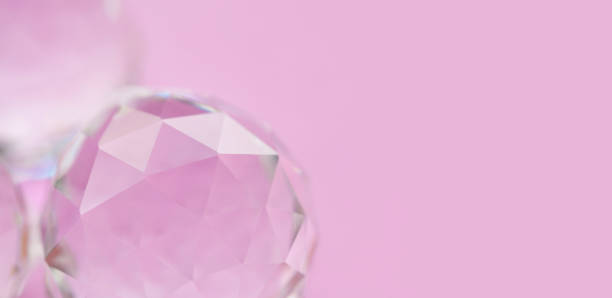 abstract diamond stone on pink background. beautiful crystal gem, geometric polygon shapes. macro view, shallow depth of field, copy space photo - low poly rose stock photos and pictures