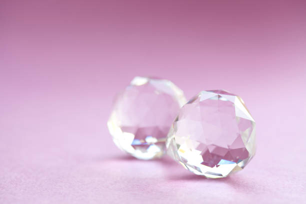 abstract diamond stones on pink background. beautiful crystal gems, geometric polygon shapes. macro view, shallow depth of field, copy space photo - low poly rose stock photos and pictures