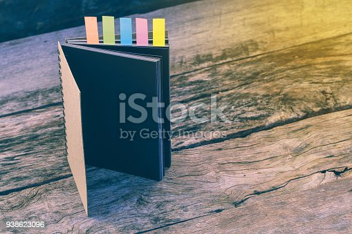 istock Abstract diary with colored tabs for bookmarks. Closeup of multi-coloured stickers with notebook, Different sticky colorful paper tag label. Vintage picture tone. Case study concept. copy space. 938623096