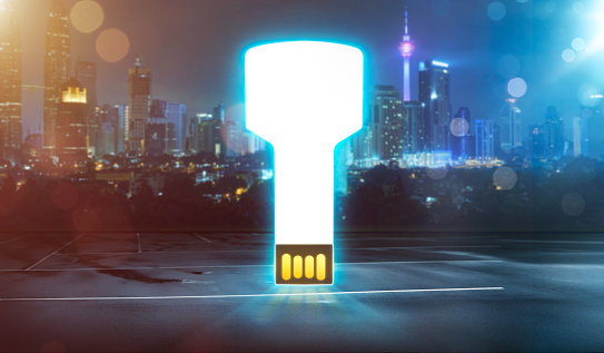 Abstract digital USB key on alley with city background , night scene.