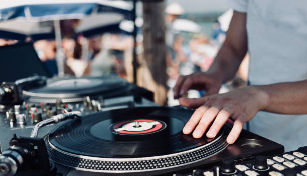Abstract DJ background DJ's hands and turntable. Summer beach party dj stock pictures, royalty-free photos & images