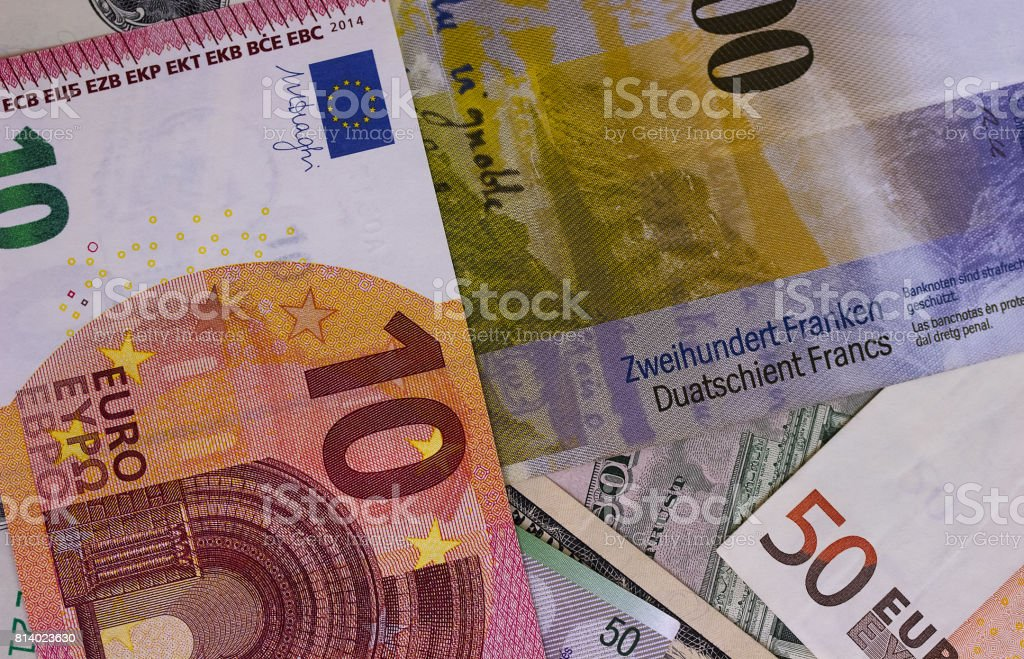 Abstract dollar euro and swiss franc background. stock photo