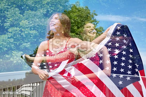 istock Abstract double exposure of photos of woman waving American Flag 470764178