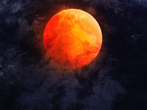Abstract dramatic night sky with full red moon for Halloween background.