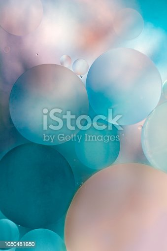 Oil Drops in Water on a colored Background