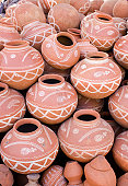 Abstract image of hand painted earthenware jar which is used for cooling the water naturally.