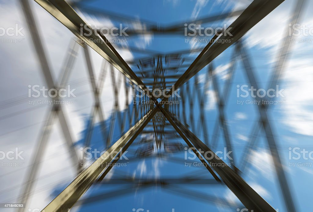 Abstract electricity pylon from below stock photo