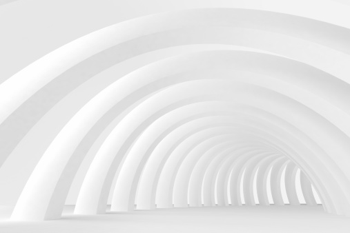 Abstract empty architecture indoor space with brighty lit white objects and shapes. Geometric shapes and arches arrayed in a tunnel like space. Modern design with no people.