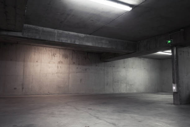 Abstract empty garage interior, background Abstract empty garage interior, background with concrete walls and white ceiling lights warehouse interior stock pictures, royalty-free photos & images