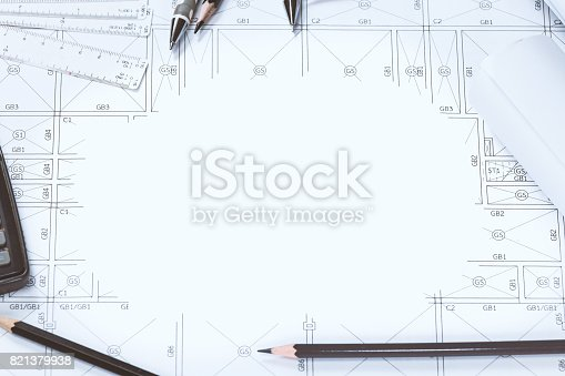 istock Abstract engineering drawings background with blank for your word. Construction plan tools with empty space on desk. 821379938