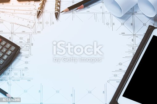 479023658 istock photo Abstract engineering drawings background with blank for your word. Construction plan tools with empty space on desk. 821379946