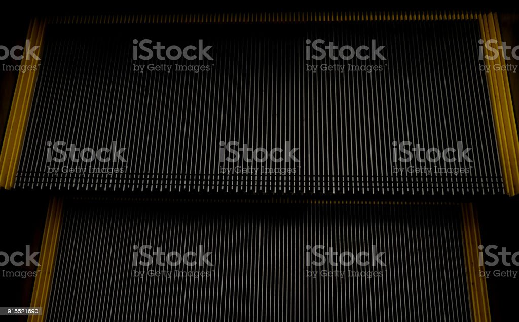abstract escalator in shopping mall, Moving up staircase, yellow...
