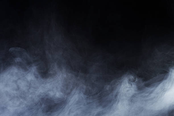 abstract ethereal smoke rising up from the ground - black background stock pictures, royalty-free photos & images