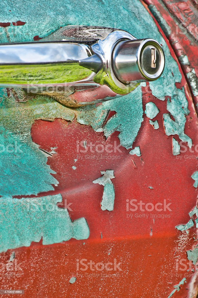 Abstract, fading paint on handle of close up truck. stock photo