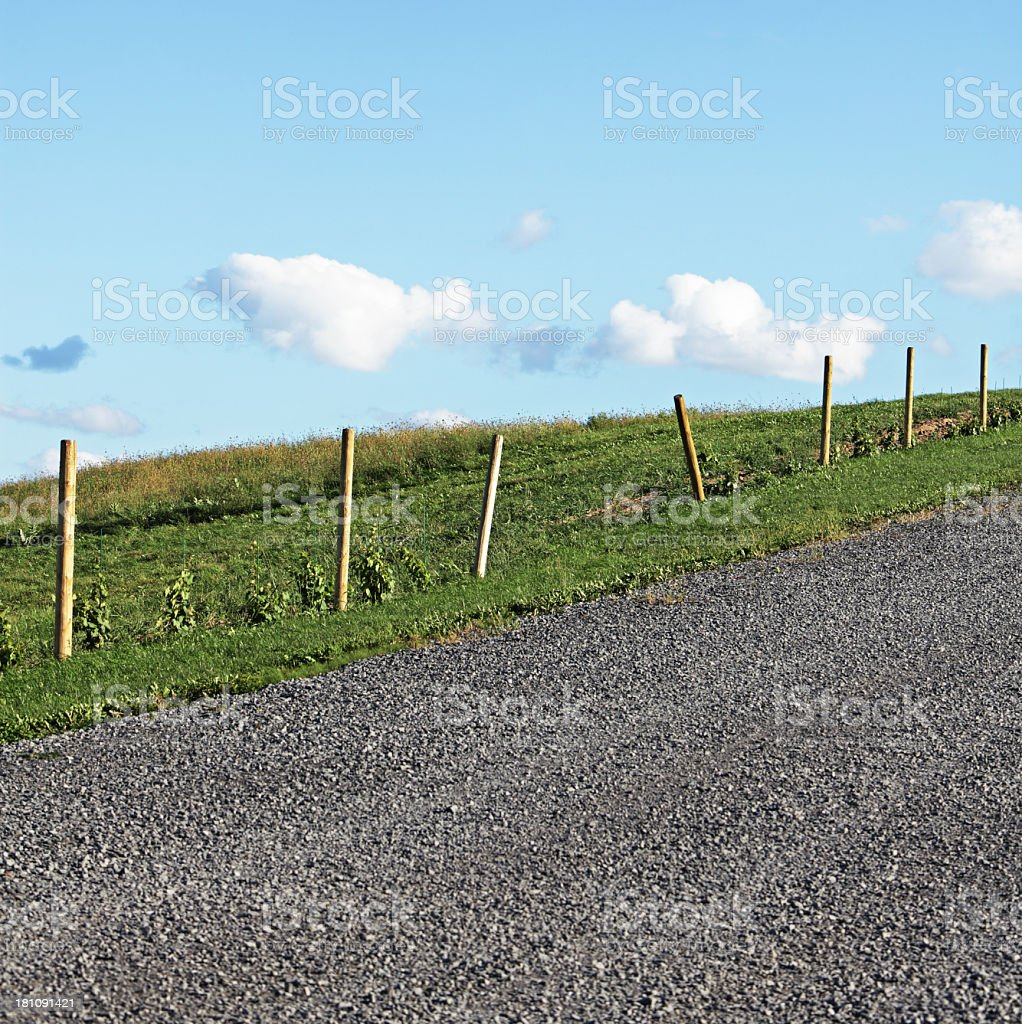 Abstract Fence And Gravel Country Road royalty-free stock photo