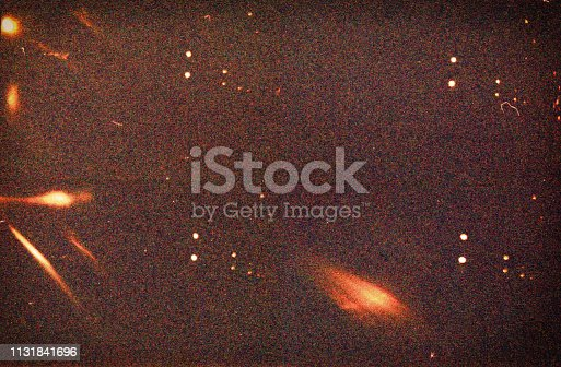 Abstract film texture background with heavy grain, dust and light leaks