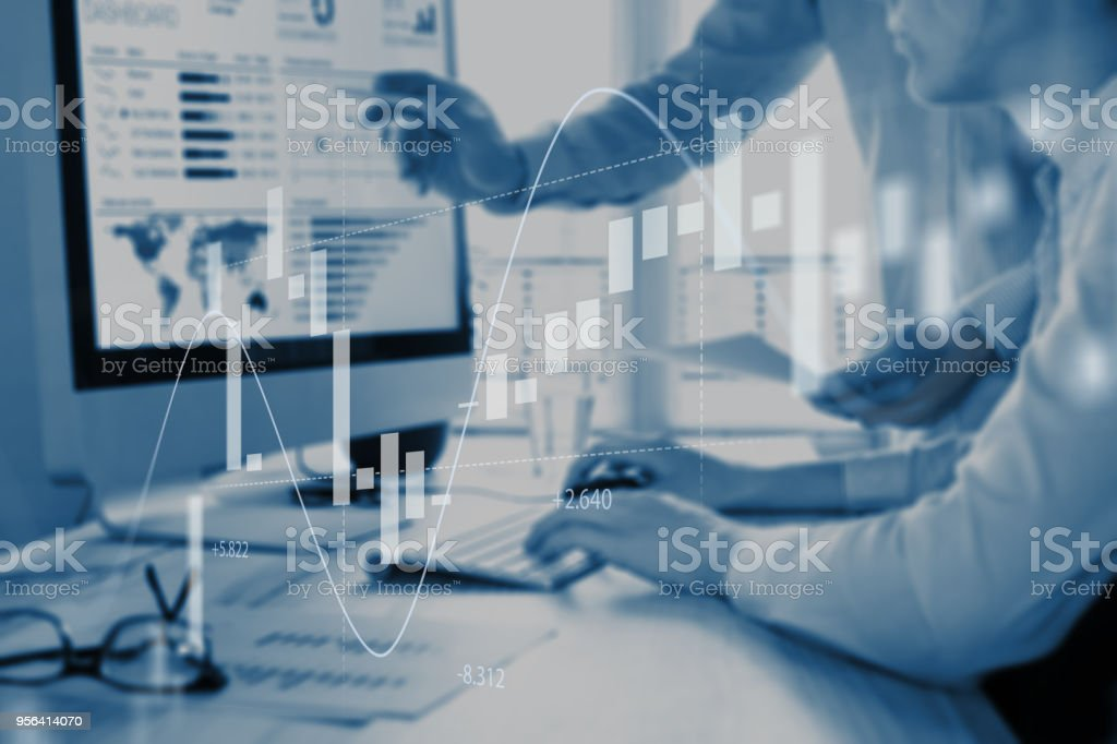 Abstract finance concept, people discussing financial data, stock market chart stock photo