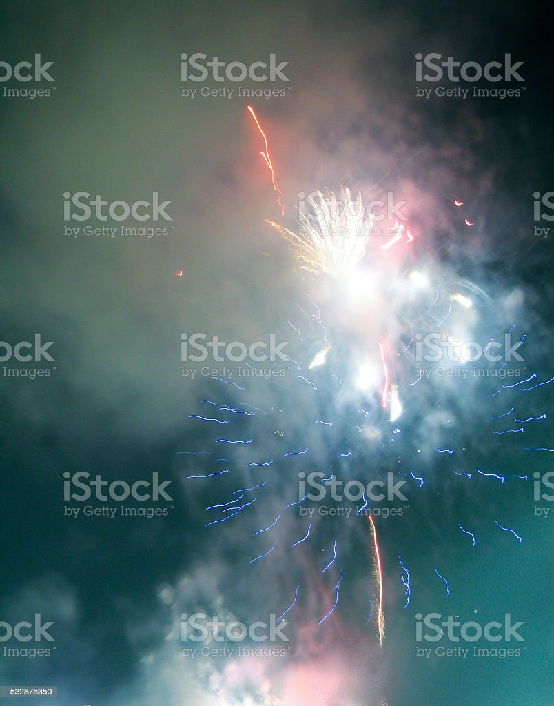 Abstract firework patterns in the night sky stock photo