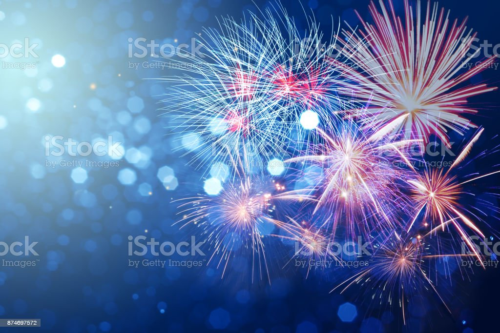 Abstract fireworks celebration on bokeh festive  light background stock photo