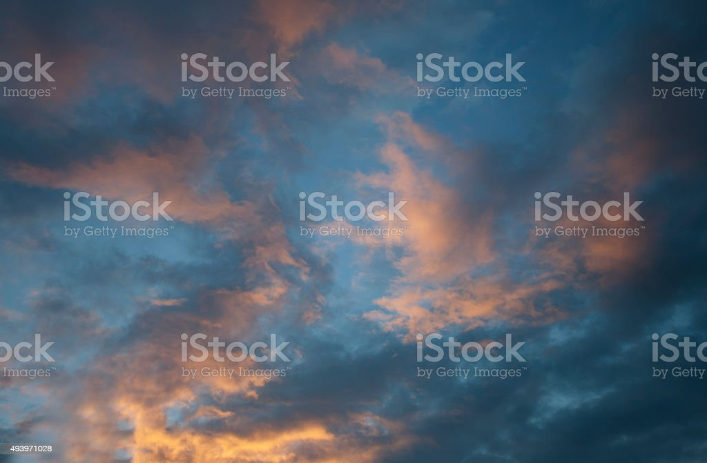 abstract fish scale colorful clouds in the sunset stock photo