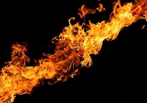 istock Abstract flame sword illuminating the dark 1209680605