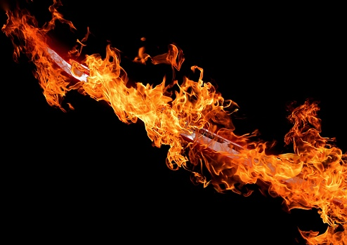 istock Abstract flame sword illuminating the dark 1209680609