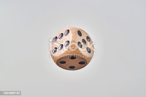 istock Abstract floating wooden dice on white background 1064888162