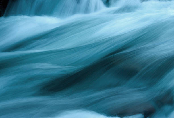 abstract flowing water - flowing stock pictures, royalty-free photos & images