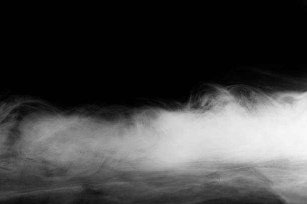Abstraite fumée brouillard ou de mouvement sur fond noir - Photo