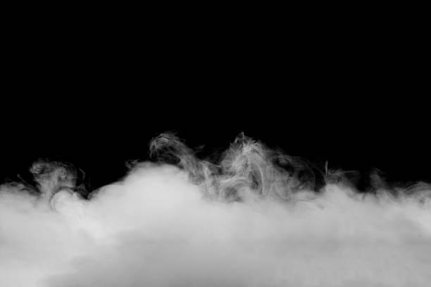 astratto nebbia o fumo movimento su sfondo di colore nero - ice on fire foto e immagini stock