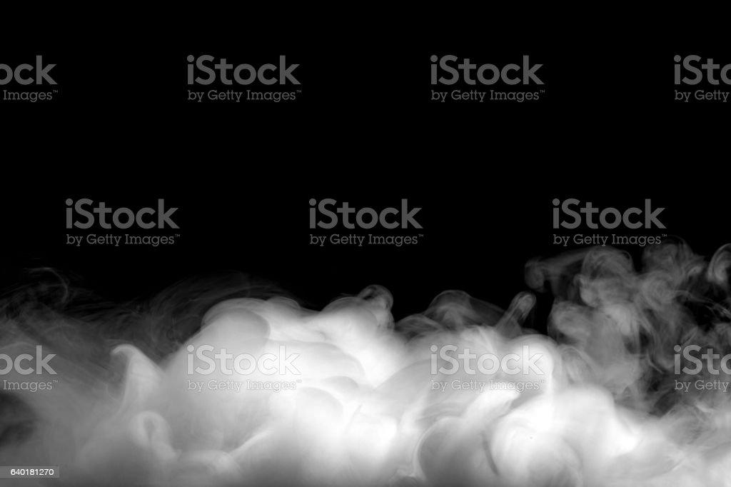 Nevoeiro se ou fumaça abstrata em fundo preto foto de stock royalty-free