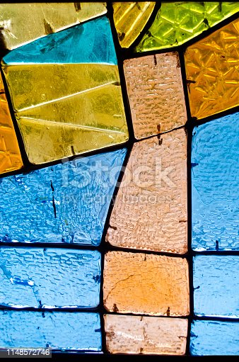 532107582 istock photo Abstract geometric colorful background. Multicolored stained glass. Decorative window of various colored rectangles. 1148572746