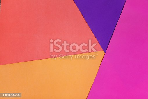 istock Abstract geometric colorful paper background. Pink, orange and coral color. 1128999706