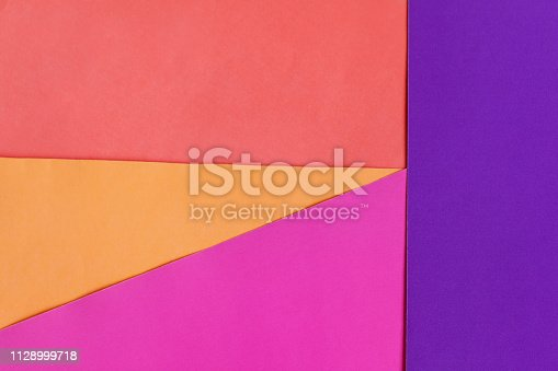 istock Abstract geometric colorful paper background. Pink, orange and coral color 1128999718
