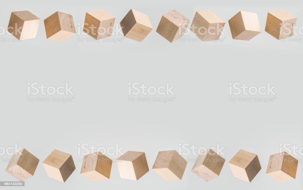 Abstract geometric real floating wooden cube on grey background foto stock royalty-free