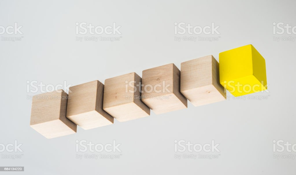Abstract geometric real floating wooden cube on grey background zbiór zdjęć royalty-free