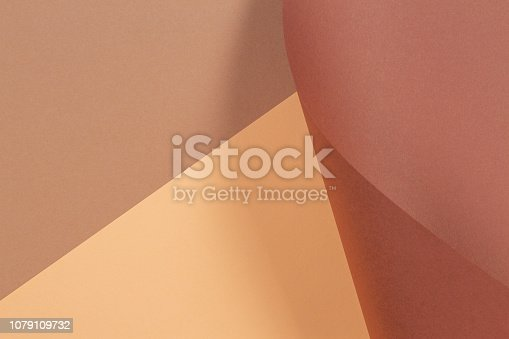 istock Abstract geometric shape beige yellow brown color paper background. 1079109732
