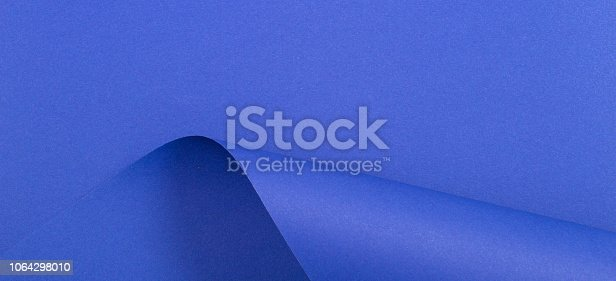 istock Abstract geometric shape blue color paper background 1064298010