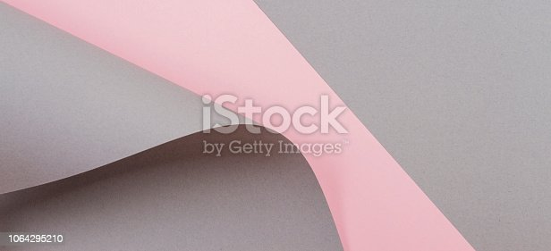 istock Abstract geometric shape gray and pink color paper background 1064295210
