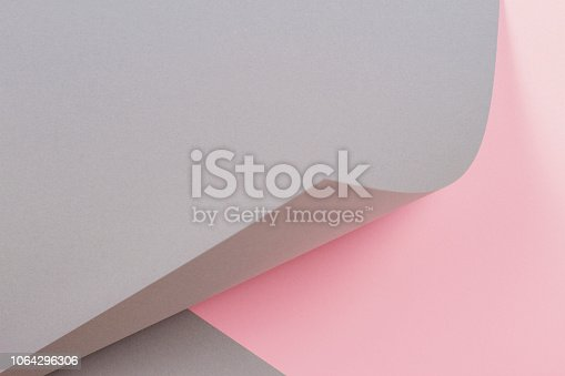 istock Abstract geometric shape gray and pink color paper background 1064296306