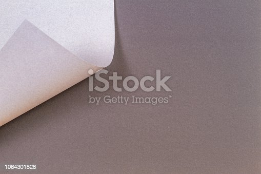 istock Abstract geometric shape gray color paper background 1064301828