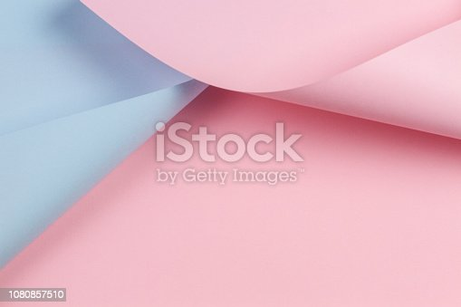 istock Abstract geometric shape pastel pink and blue color paper background 1080857510