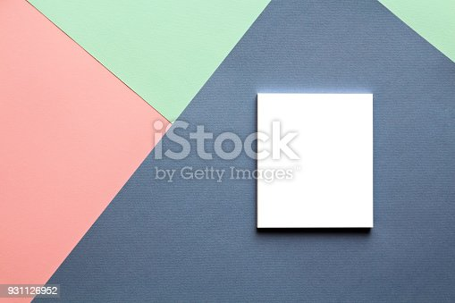 857920492istockphoto Abstract geometric watercolor paper background in trend colors with notebook. 931126952