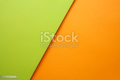 857920492istockphoto Abstract geometricpaper background in green and orange colors 1172230333